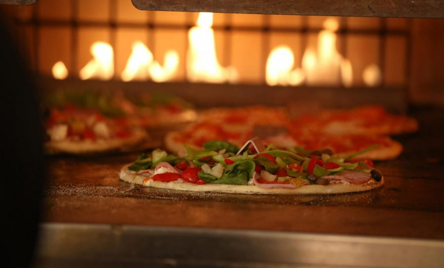 Blaze Pizza differentiates itself from traditional pizza chains with its ovens, promising custom pies with short waits.