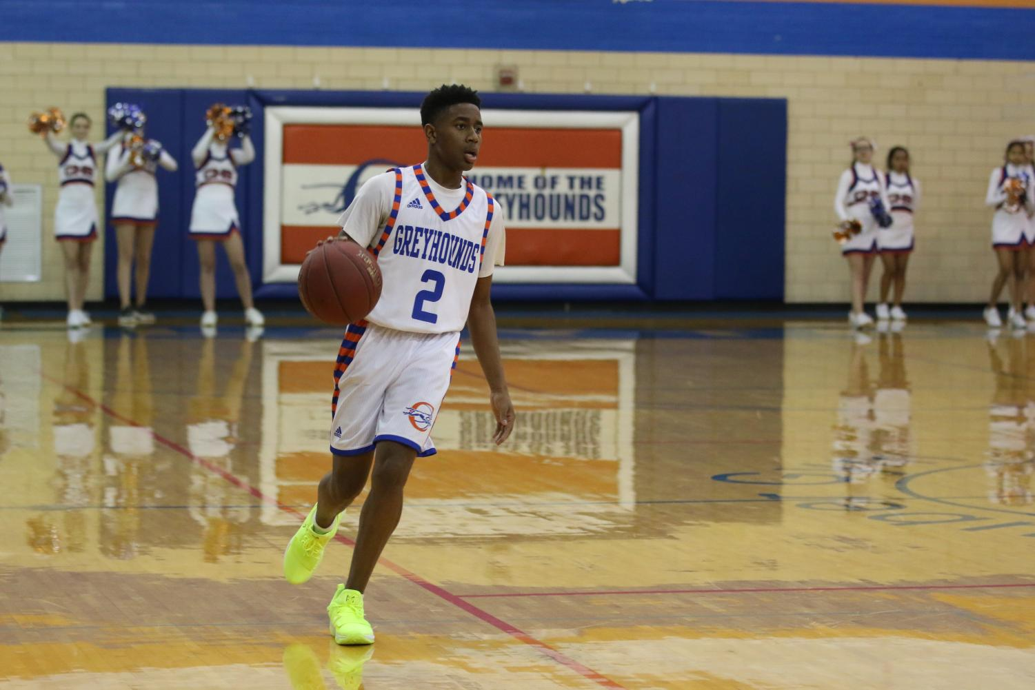 Senior Robert Hancock moves up the court with the ball during the 2017-18 season's Coaches vs. Cancer game against Ladue.