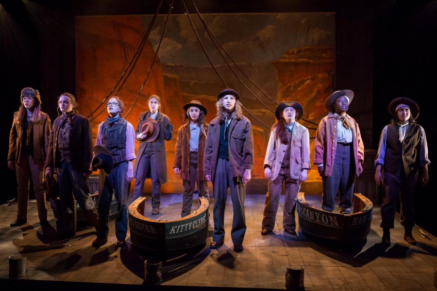 The cast of the CHS fall play, Men on Boats, stands together on stage during the performance.