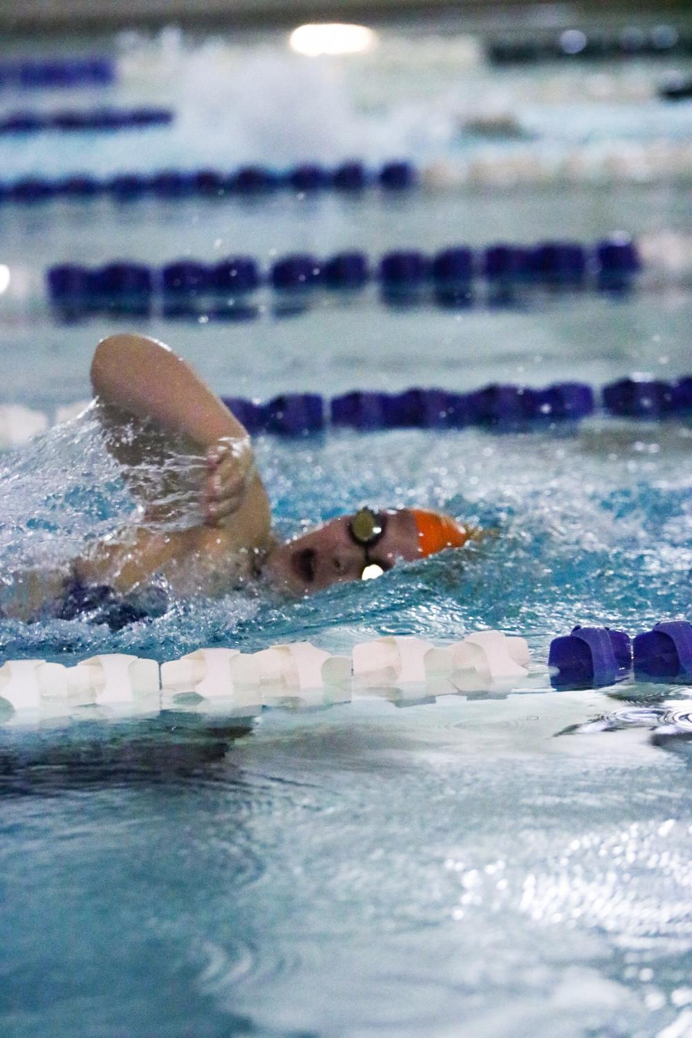 Senior Elizabeth Miller competes in a freestyle event at a swim meet.