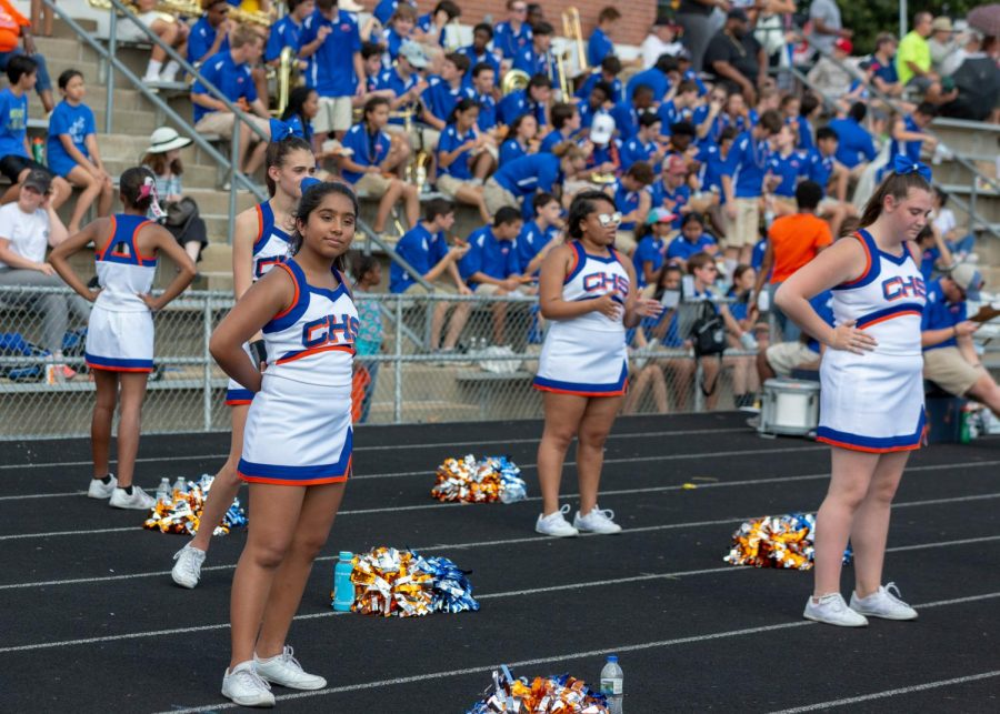 Members of the fall cheerleaders' team perform at the CHS homecoming game. Some fall cheerleaders join either the dance team or the winter cheerleading team, which stands alongside the dance team at games.