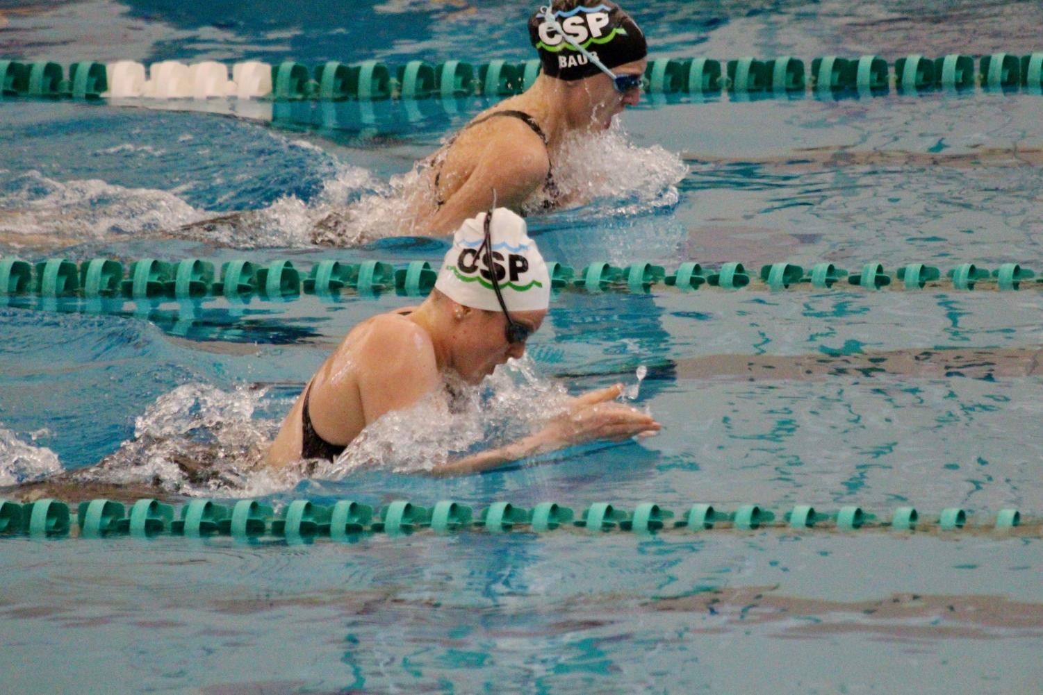 Mottl competes in a breaststroke event during a swim meet.