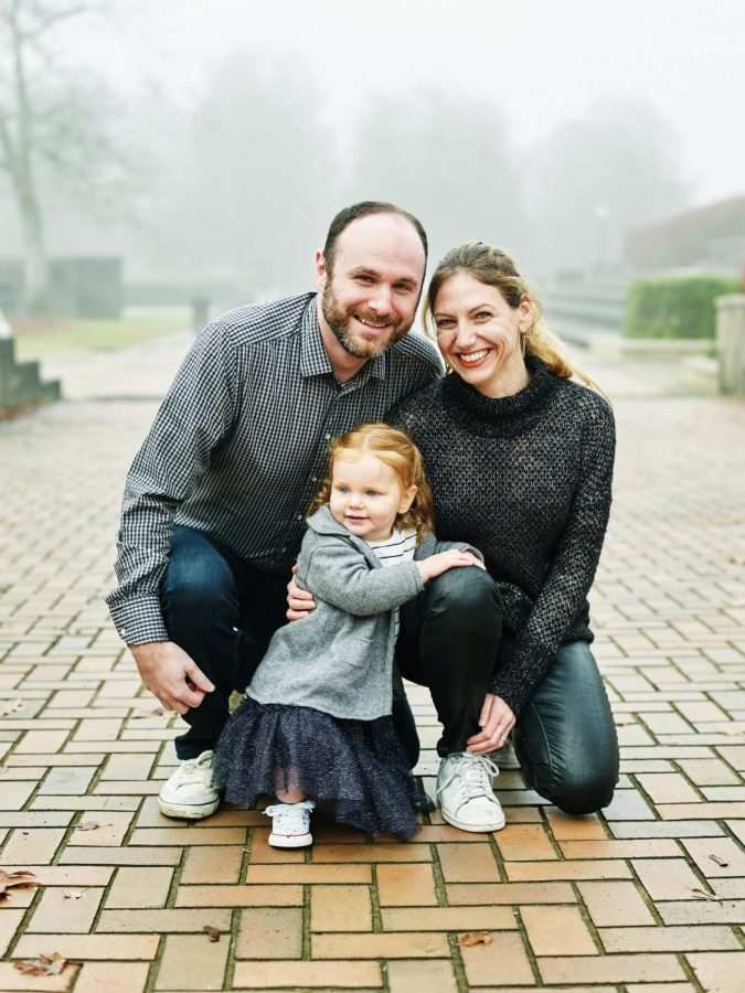 Kate Berland, Class of 1999, sits for a family photo with her two-year-old daughter and husband. Berland works in marketing at Google, but says that whats more important to the job is coming home to something thats truly important to her--her family.
