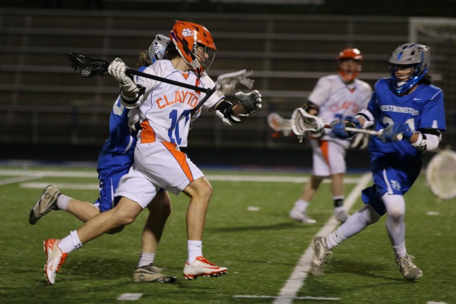 Max Murphy, class of 2017, carries the ball down the field during a lacrosse game.