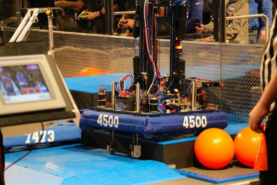 Team 4500s robot climbs to the second HAB level during a match.