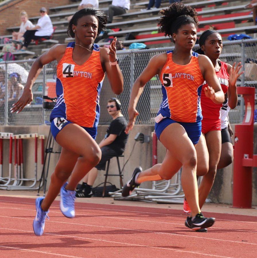 Two CHS track athletes compete in the 100m dash