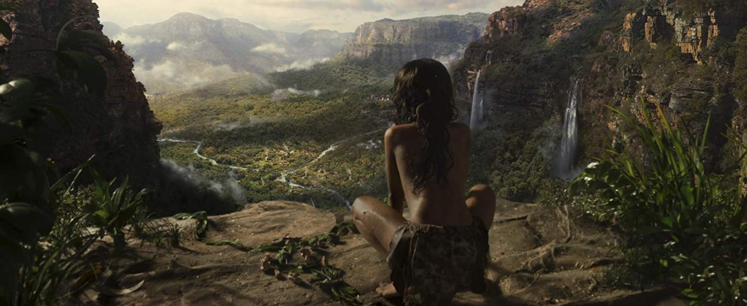 Rohan Chand stands atop a cliff in Mowgli: Legend of the Jungle (2018).