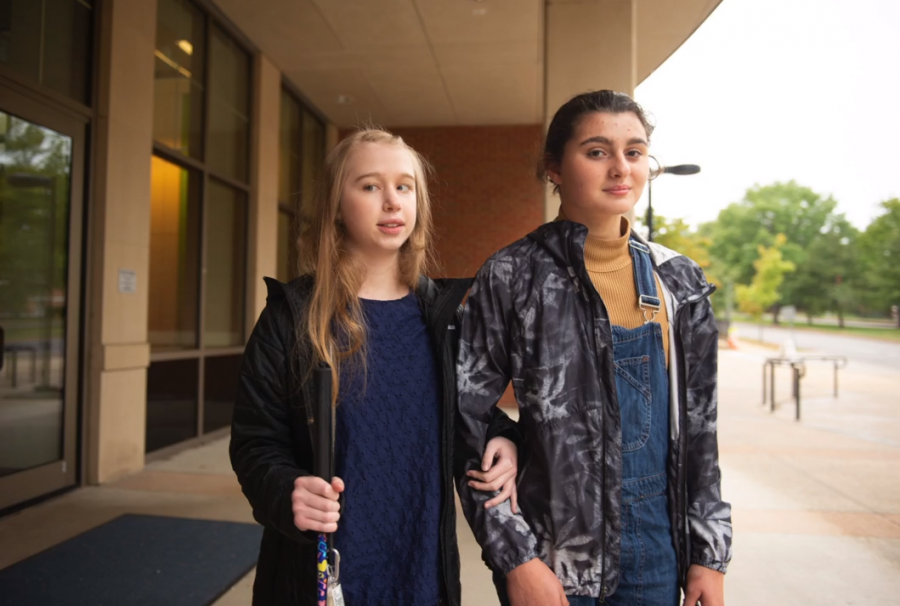 Holly Connor (left) stands with Sara Parietti (right) outside of Wydown Middle School.