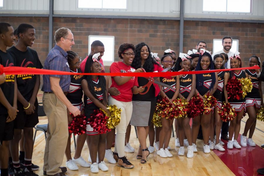 LFLA founder Marshall Cohen (third from left) and students at the ribbon cutting ceremony for the school's new gym.