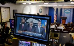 Attorney General William P. Barr is seen on TV monitors in the briefing room of the White House as he delivers remarks on the release of the report on the investigation into Russian interference in the 2016 presidential election April 18, 2019 in the White House in Washington, D.C.