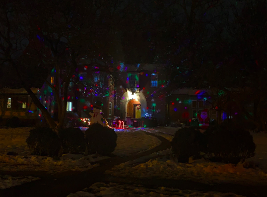 Amazing colorful projects lights on a house on Wydown Blvd.