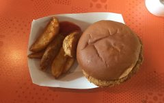 Picture of a hamburger and potato wedges, found in the CHS Cafeteria.