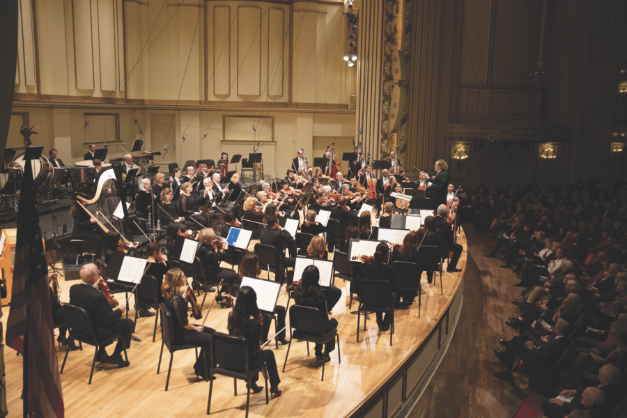 The SLSO performing on stage with music director Stéphane Denève conducting.