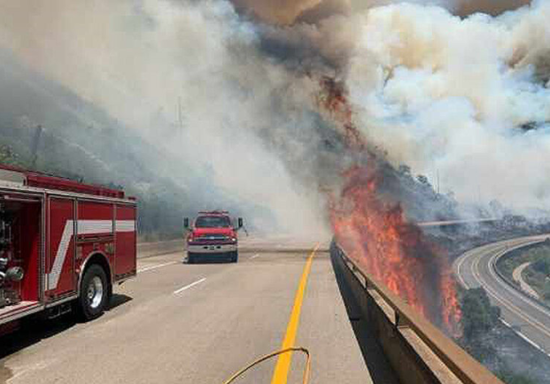 A portion of one of the wildfires was burning in the median between Interstate 70 in both directions.