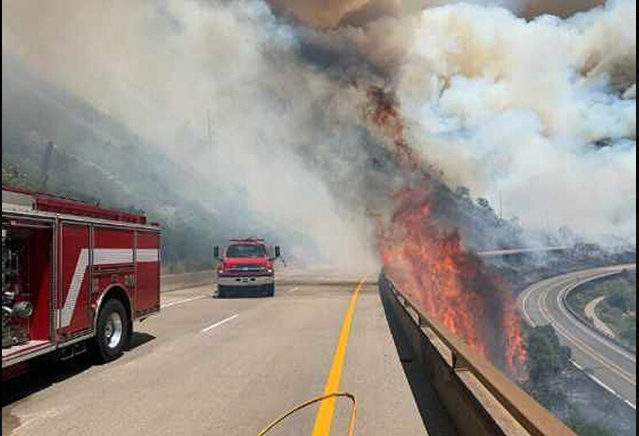 A+portion+of+one+of+the+wildfires+was+burning+in+the+median+between+Interstate+70+in+both+directions.