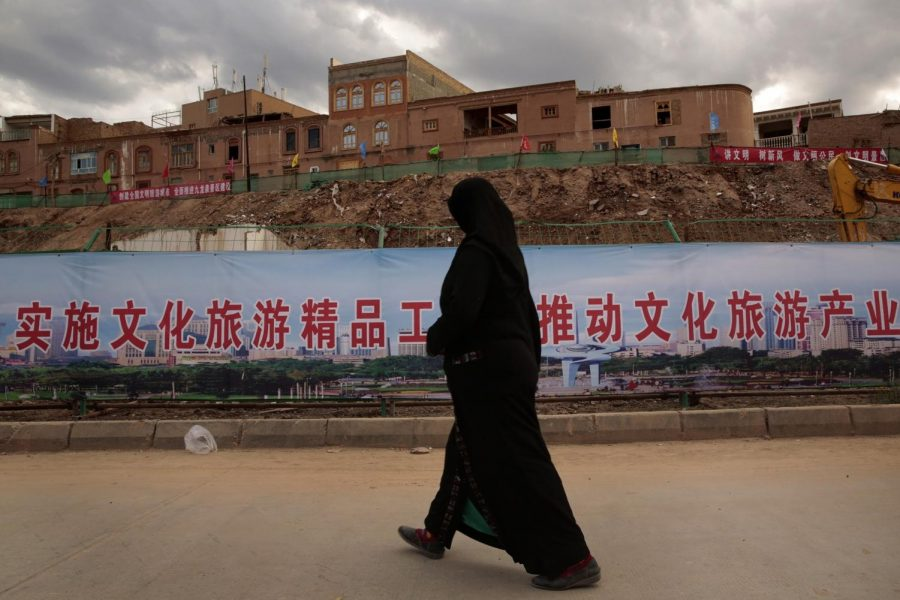 An Uyghur woman walks along an area of reconstruction in Kashgar, China. Many homes in the old urban district of Kashgar are being reconstructed, and many have been raised to build a new park. (Los Angeles Times/MCT)