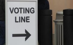 A voting line sign. Voting has been restricted to those over 18.