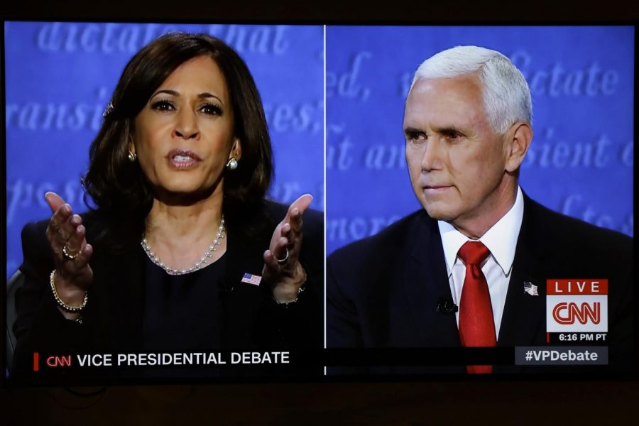 Kamala Harris, left, and Vice President Mike Pence, right, participate in the vice presidential debate held at Kingsbury Hall at the University of Utah in Salt Lake City, moderated by Susan Page from USA Today.