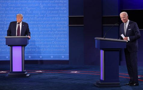 n this file photo, U.S. President Donald Trump and Democratic presidential nominee Joe Biden look out to the audience at end of the first presidential debate at the Health Education Campus of Case Western Reserve University on September 29, 2020 in Cleveland, OH.