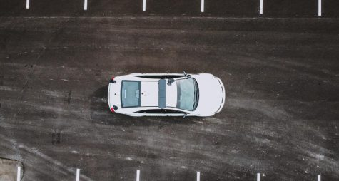 A police car on a road, photo taken from an upwards angle.