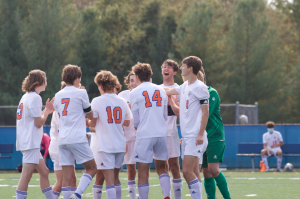 Members of the CHS boys' soccer team huddle before playing Ladue on October 17