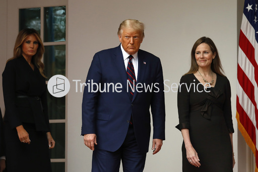 President Donald Trump with first lady Melania Trump, left, arrive to introduce Judge Amy Coney Barrett, right, as his Supreme Court Associate Justice nominee in the Rose Garden of the White House in Washington, D.C., on Saturday, Sept. 26, 2020
