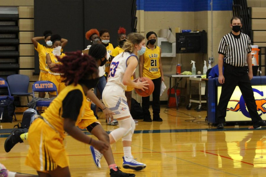 Clayton High School's Girl's Basketball team. All players are required to wear masks due to coronavirus.