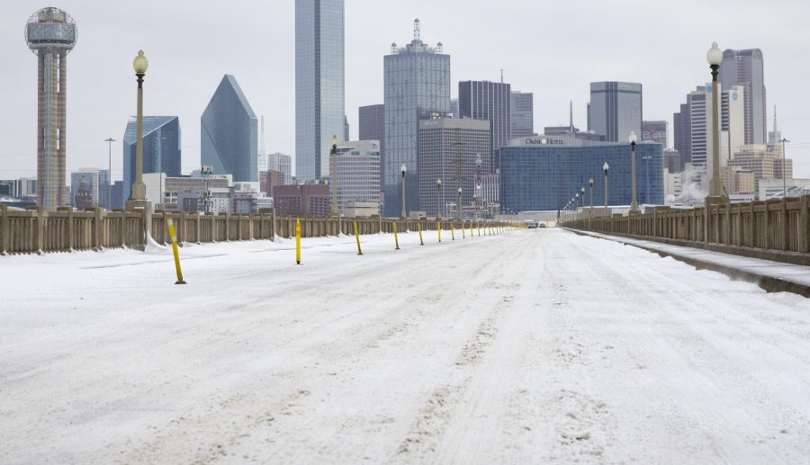 A snow-covered downtown Dallas, Texas seen from South Houston Street on Monday, February 15, 2021.