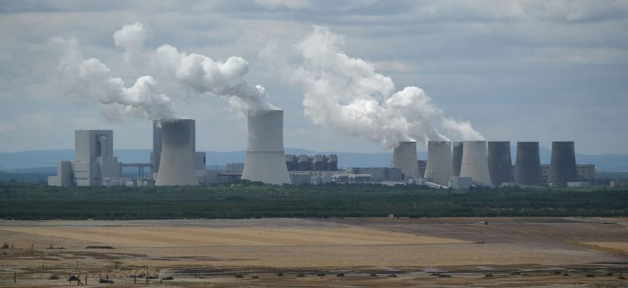 Steam rises from cooling towers of the Boxberg coal-fired power plant next to reconstituted land of the plants adjacent open-pit lignite coal mine on July 9, 2019 near Weisswasser, Germany. Legislation to phase the country off coal passed both houses of parliament Friday, July 3, 2020.