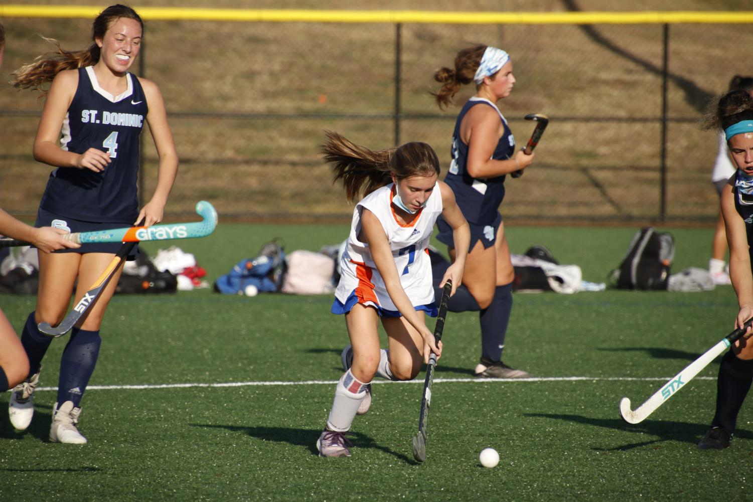 Ruby Nadin dribbles the ball past defenders in a game against St. Dominic