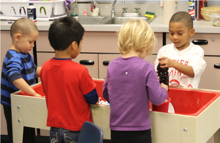 Children play in a preschool before COVID-19