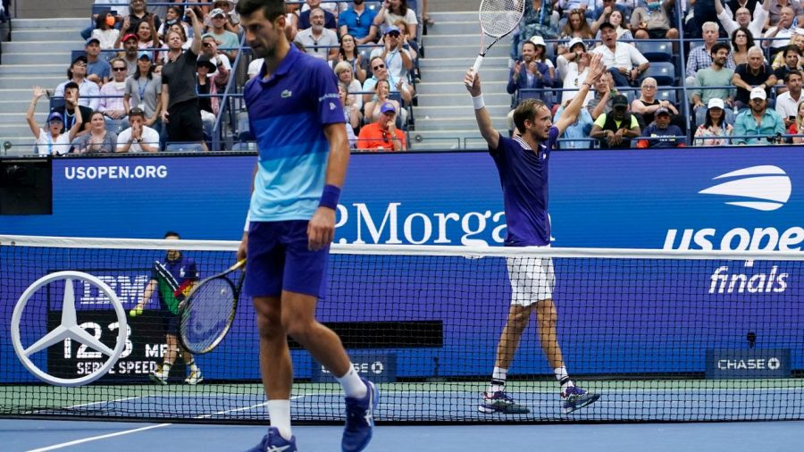 Medvedev celebrates after winning a crucial point during the match