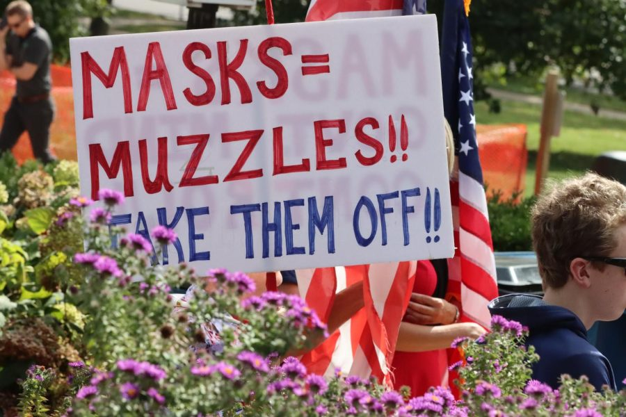 Participants at a shaw park rally held signs expressing their views, ranging from outright COVID denial to opposition to mask and vaccine mandates.